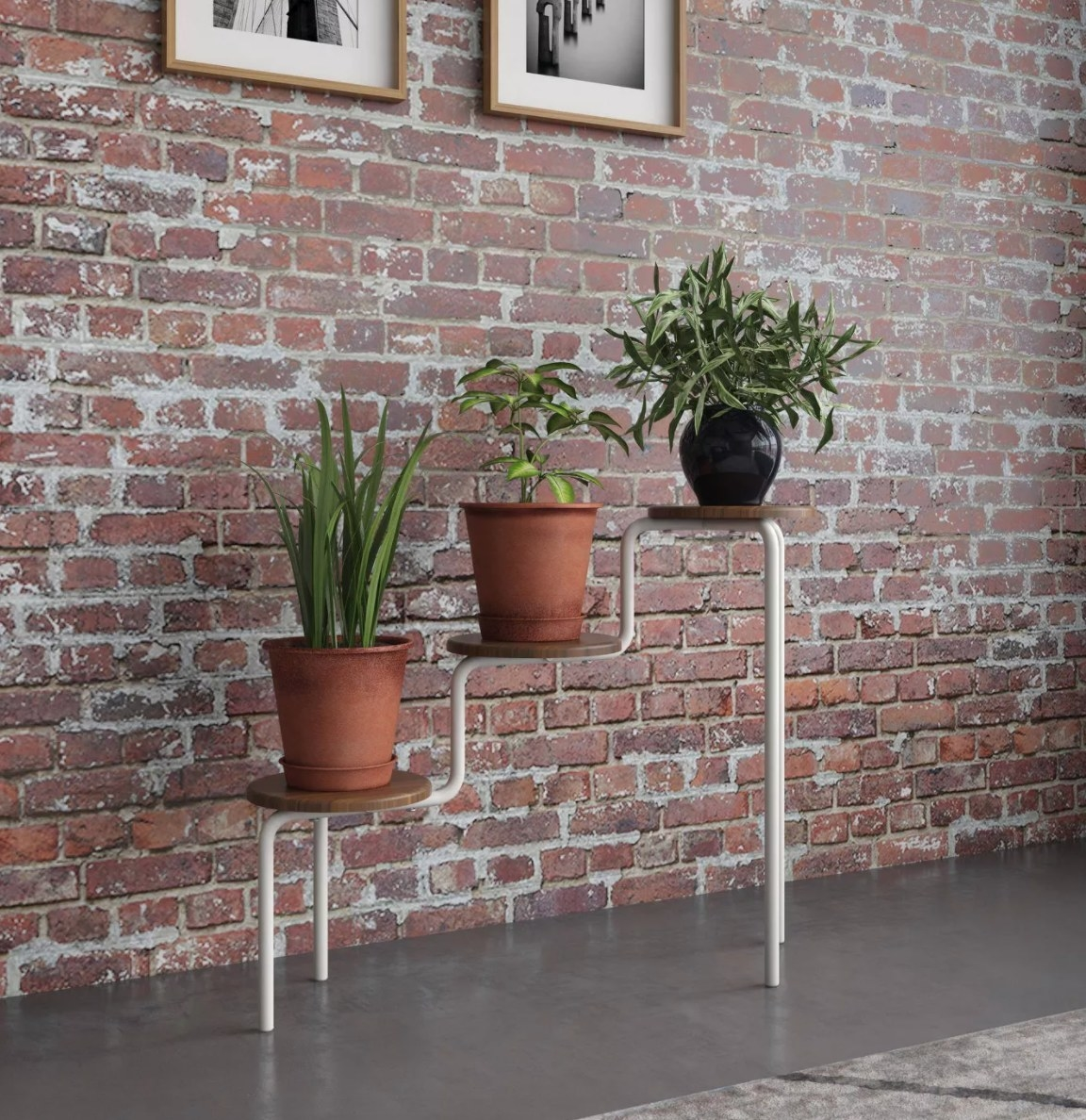 A white three-tiered plant stand with wooden tops