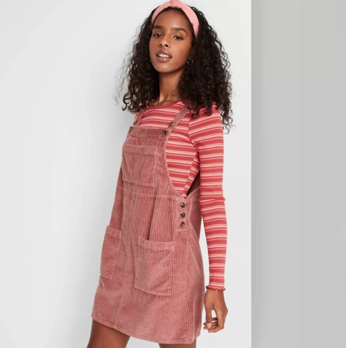 Pink overall dress with stripped long sleeve