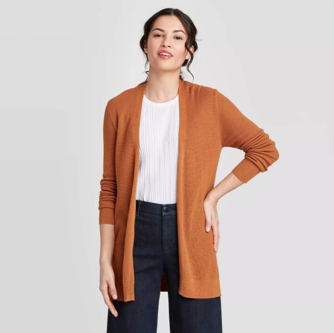Model wearing orange cardigan