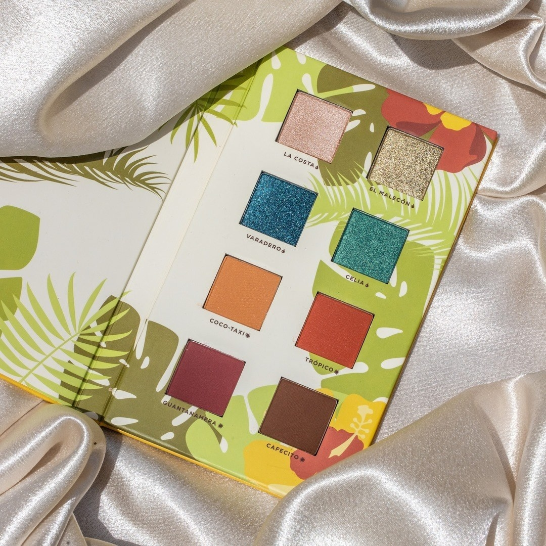 Alamar eyeshadow palette opened on silk background