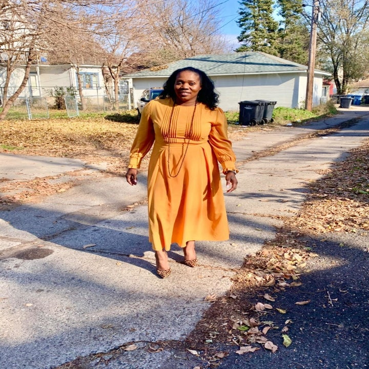 A different reviewer wearing the dress in yellow