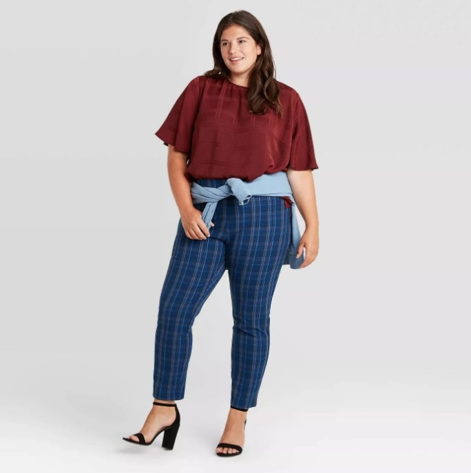 Model wearing blue plaid pants and red shirt