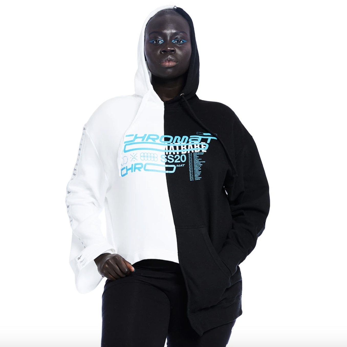 model wearing the black and white hoodie with blue writing