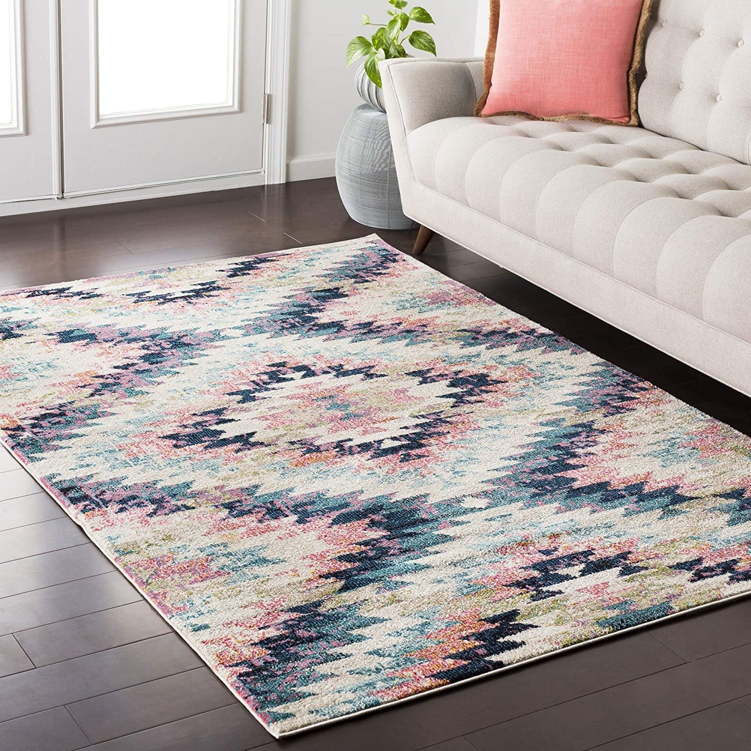 The pink, beige, and blue bohemian-style geometric rug