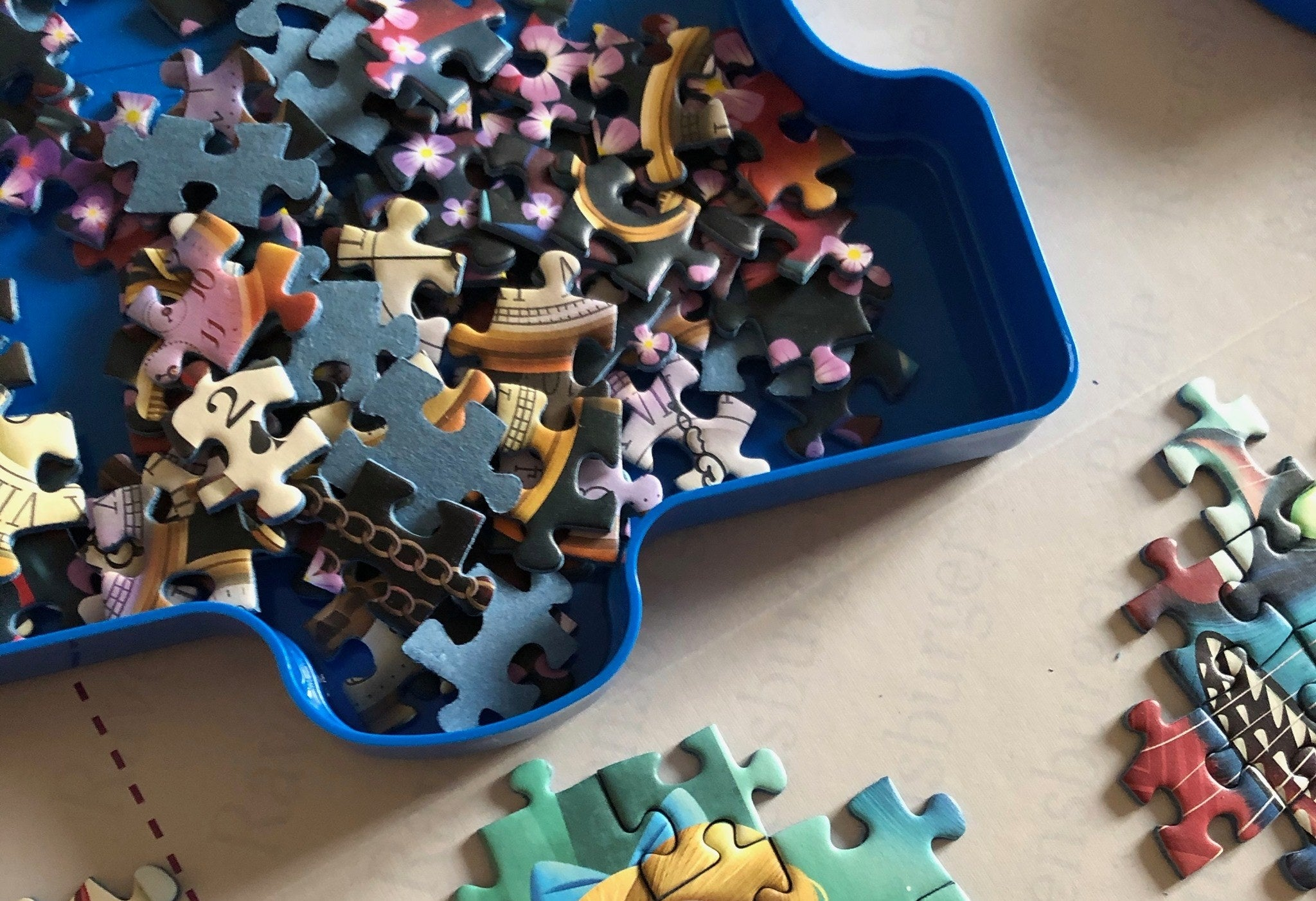 Person's puzzle being held in the sorting tray