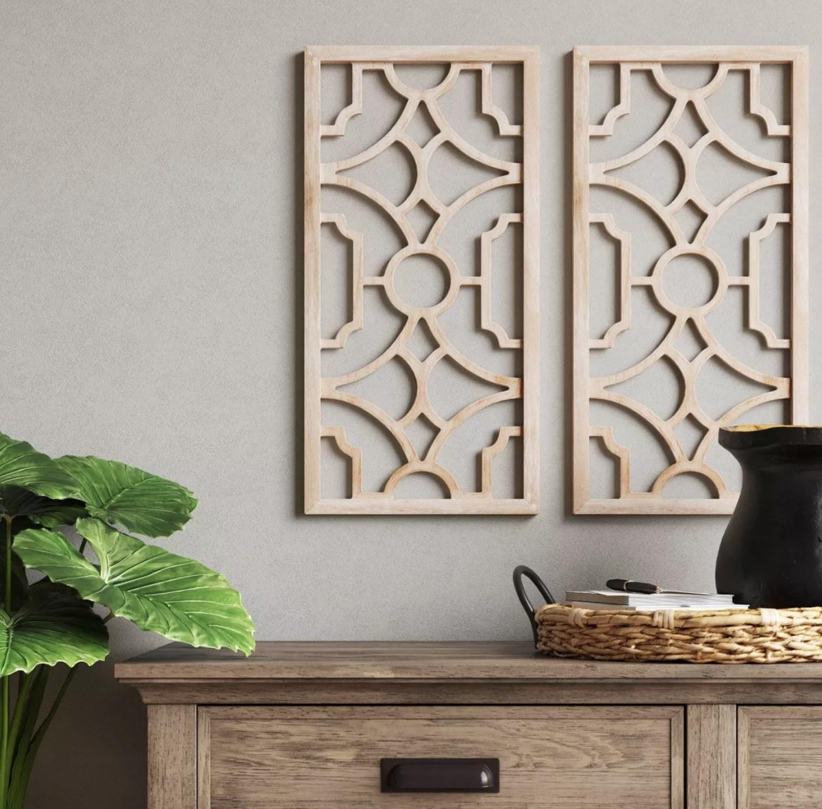 A pair of wood lattice wall hangings