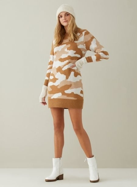 The white and tan camo sweater dress