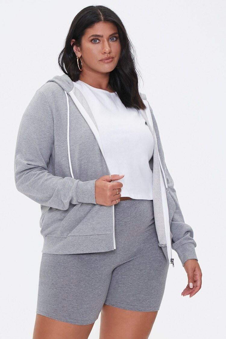 model wearing the sweatshirt in gray