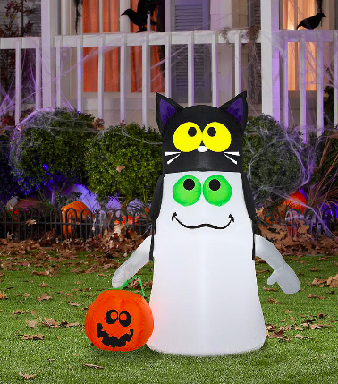A friendly looking inflatable ghost has on a cat hat