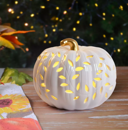 A pumpkin is lit up with LED lights