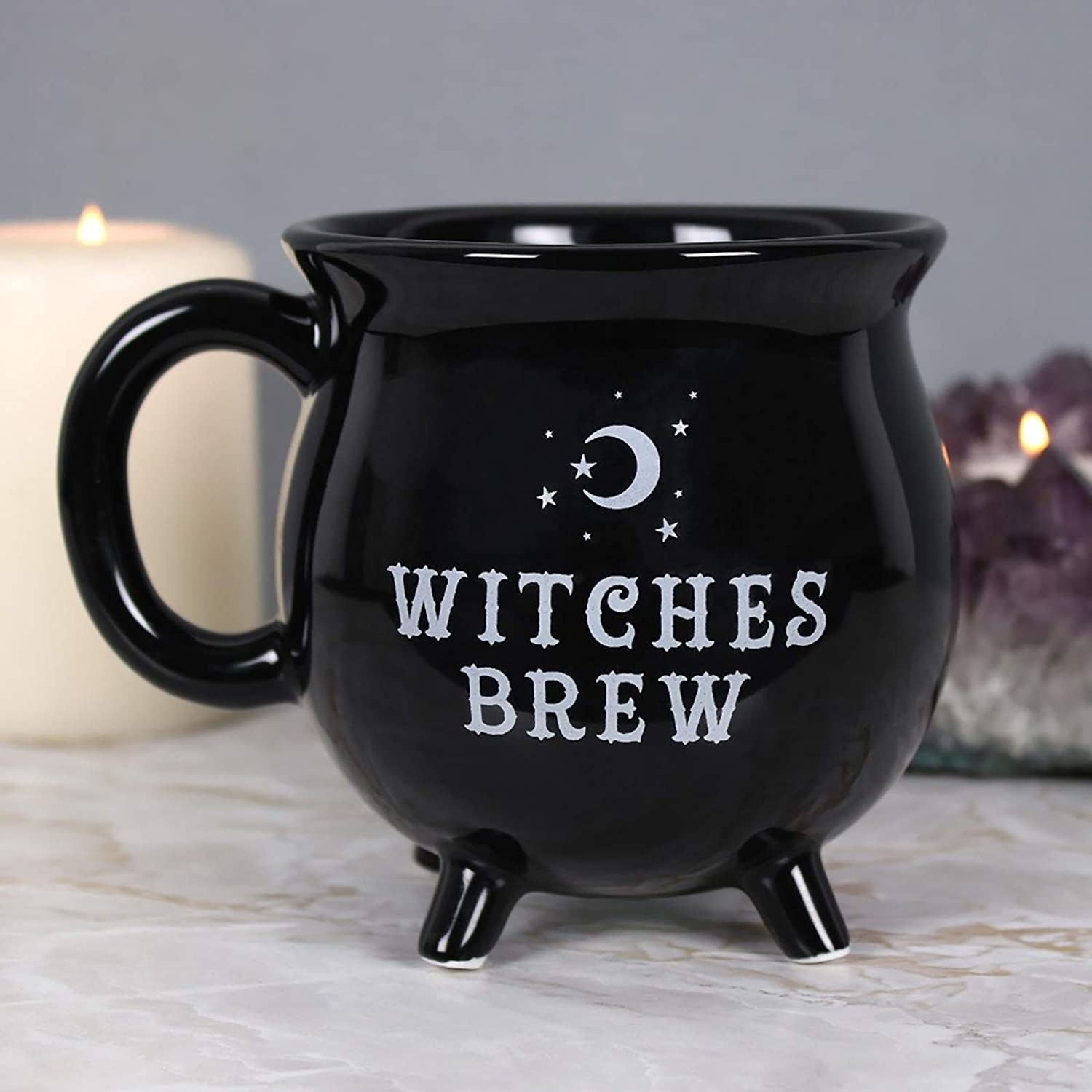A cup that says witches brew