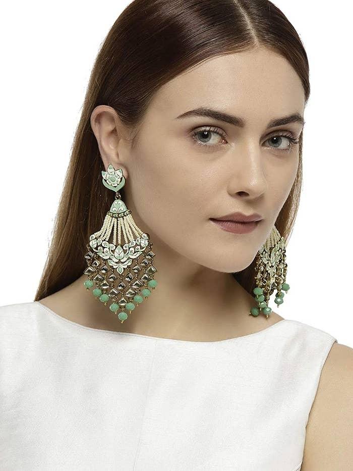 A model showcasing the earrings.
