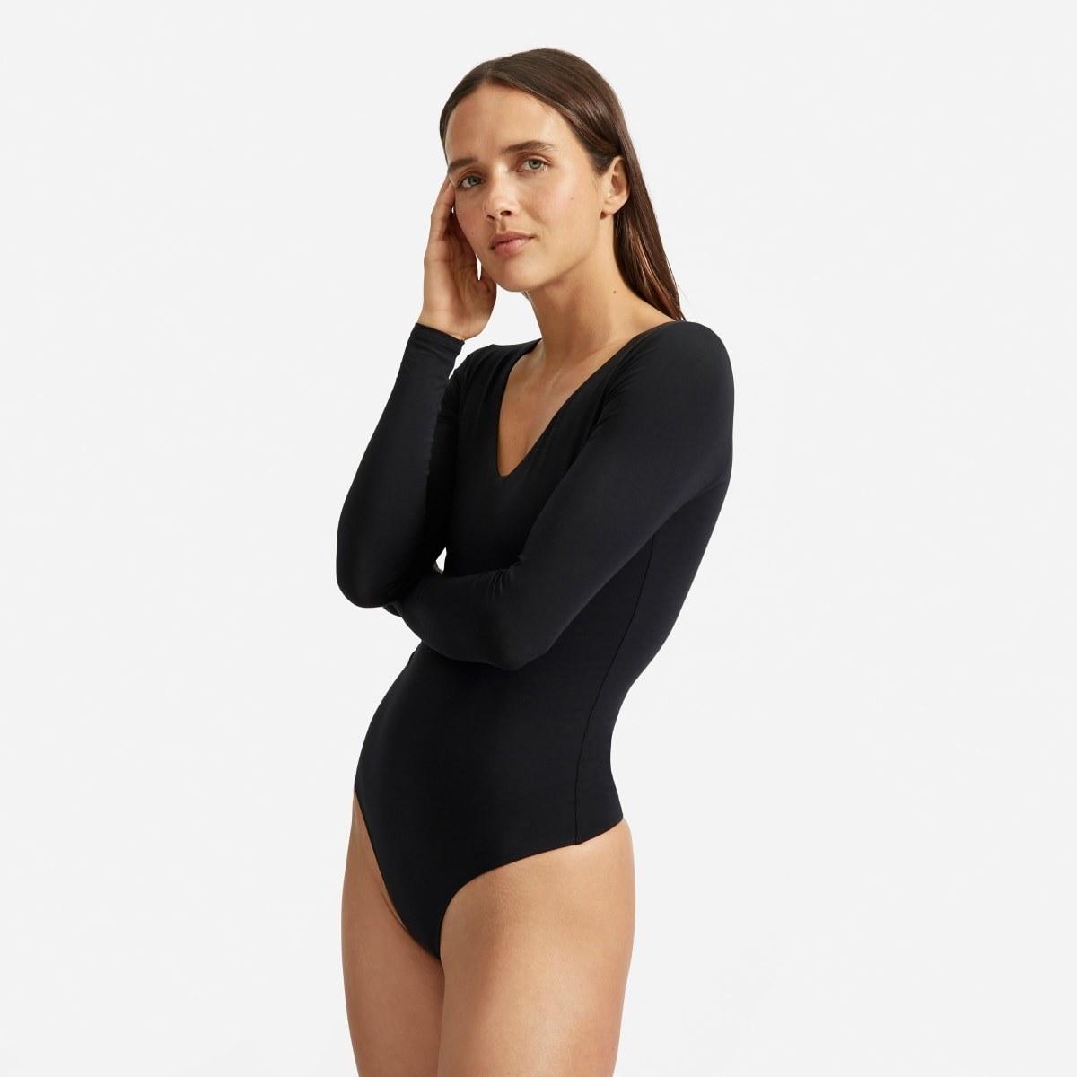 A model wearing the black long-sleeved thong bodysuit