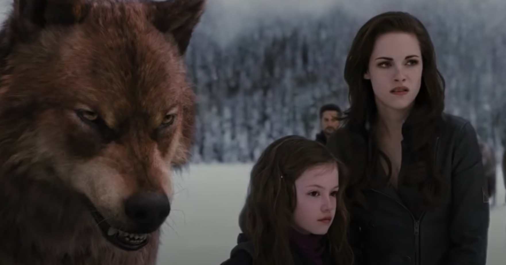 Jacob in wolf form, Renesmee, and Bella in the snow at the front lines of the battle
