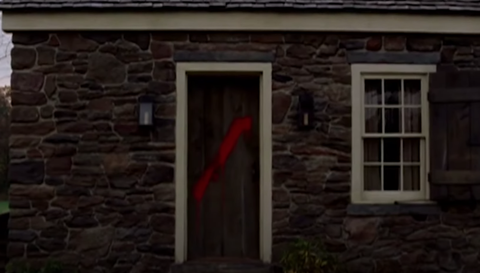 Red paint splashed on Lucius' door after he left the village