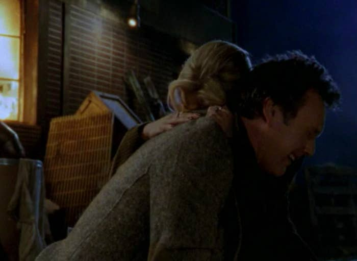 Giles sobs in Buffy's arms