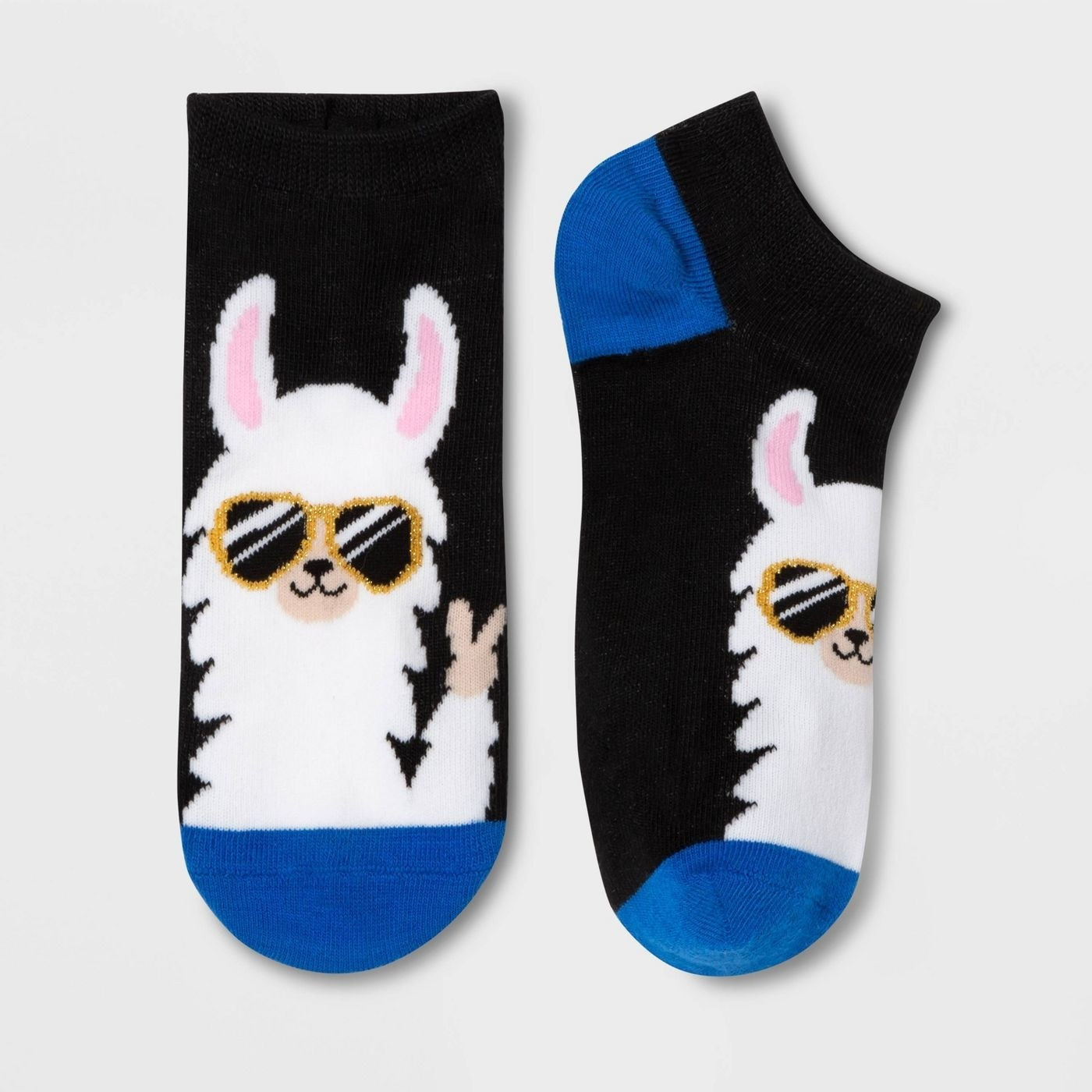 Short black ankle socks, with the image of a cartoon llama wearing sunglasses and giving the peace sign across the front of the foot