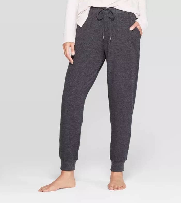 Model wearing charcoal gray jogger sweatpants