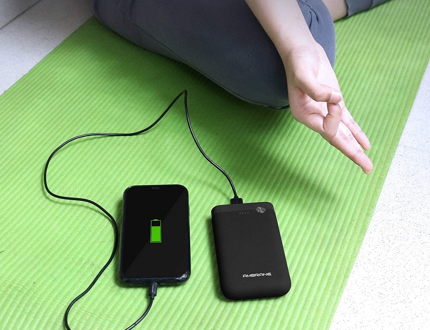 The power bank being used to charge a phone.