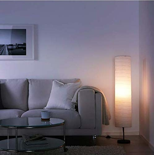 A lamp next to a sofa