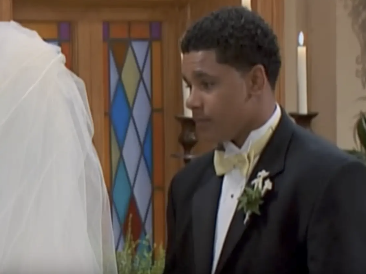 Devon in a suit about to marry Raven in a vision of hers.