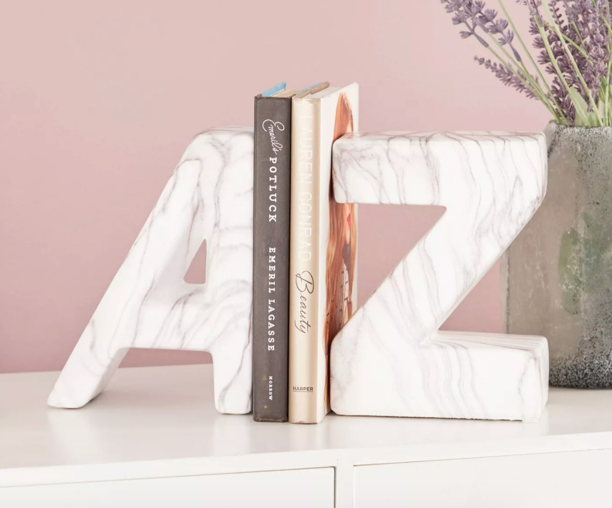 """White marble-look bookends, one is the letter """"A"""" and the other is the letter """"Z"""""""