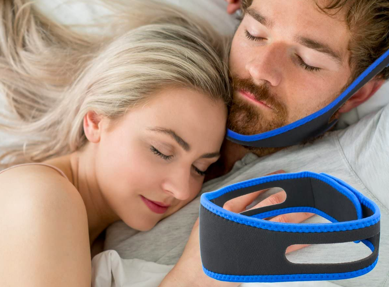 Person sleeping with strap around their chin and over their head