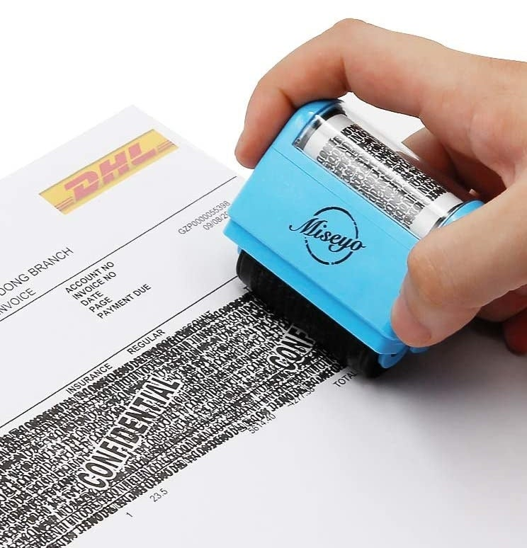 A person using the roller on a DHL invoice