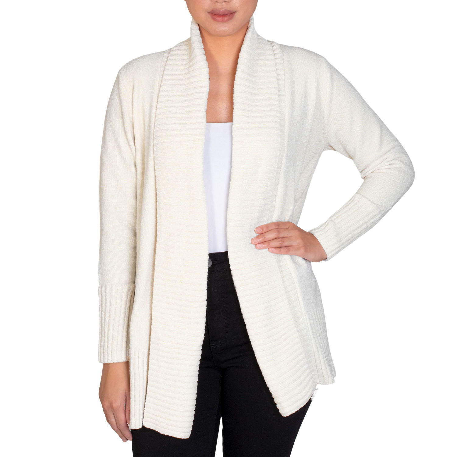 Model wearing the open cardigan, which has a shawl collar, in white