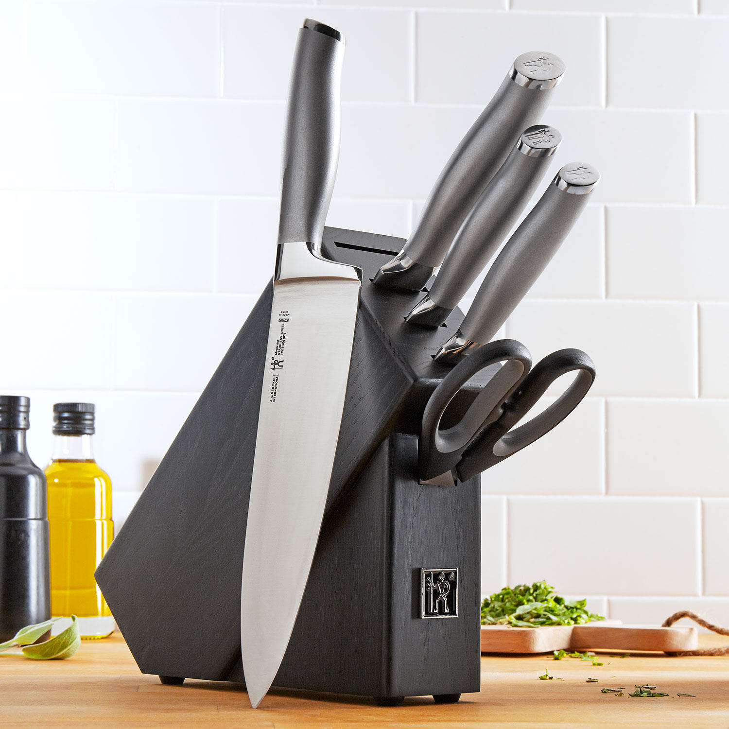 The set, which includes four knives, a pair of shears, and a knife block