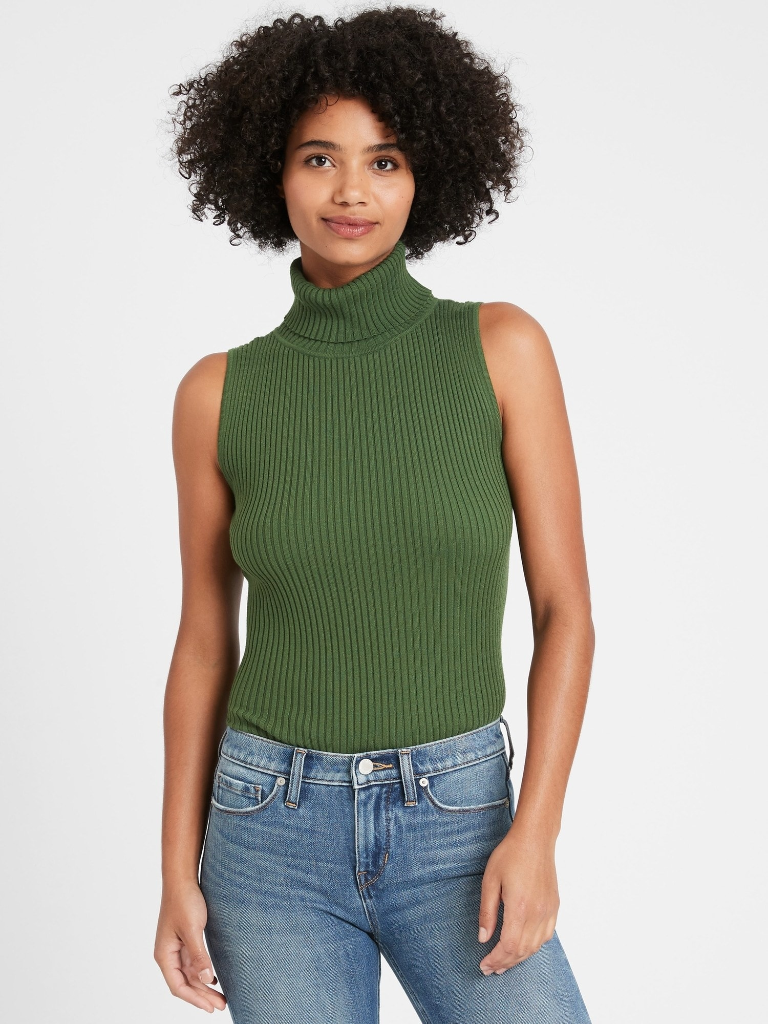A model wearing the sweater in green