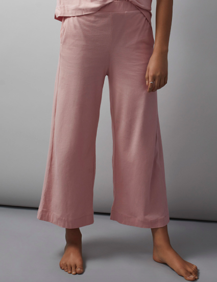 A close up of a model wearing the flared loungewear pants
