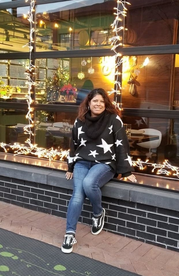 Reviewer wearing the sweater in black with white stars on it