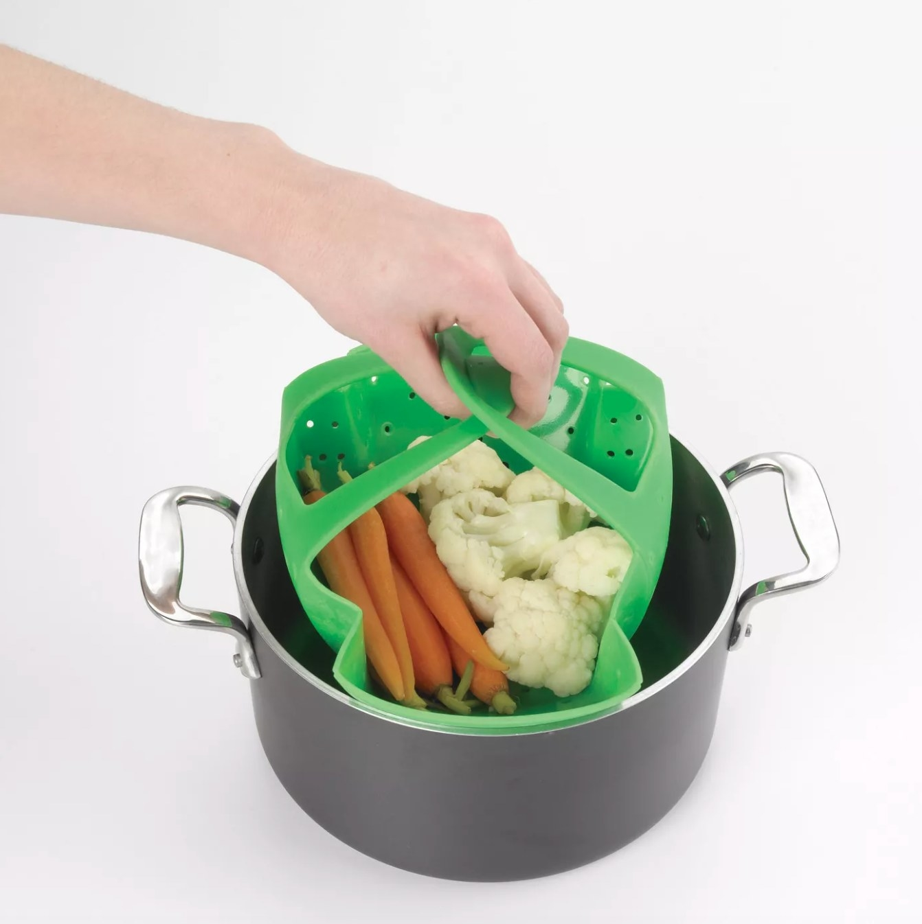 The silicone pressure cooker steamer in green with handles