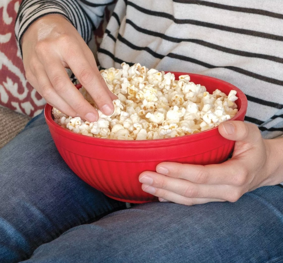 The red popcorn maker being used as a bowl