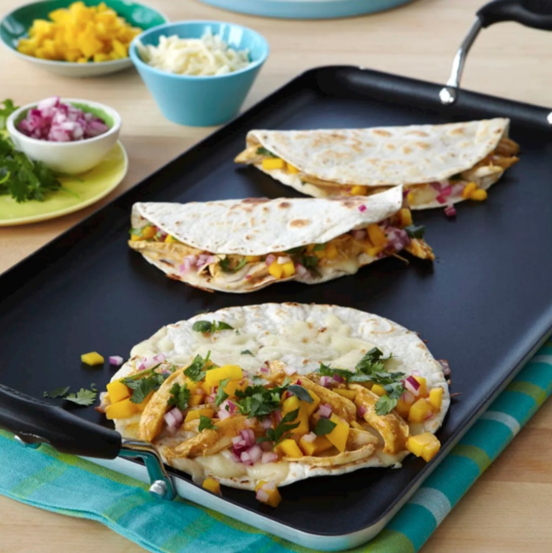 The black non-stick griddle with cool touch handles