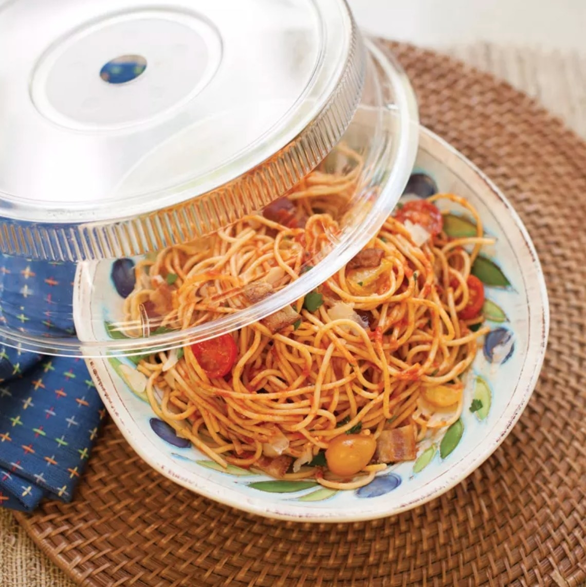 The plate cover being used over spaghetti