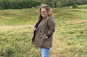 buzzfeed writer in a brown plaid blazer