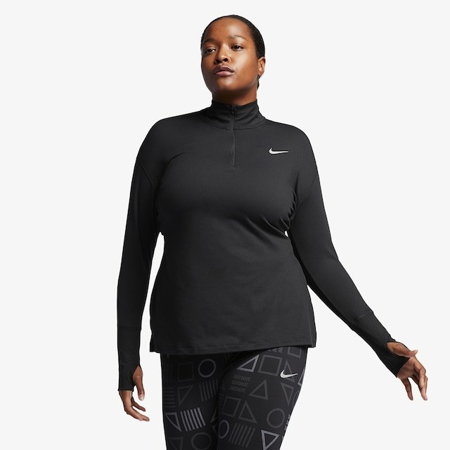 A model in the black long-sleeved top with their thumbs through the thumb holes
