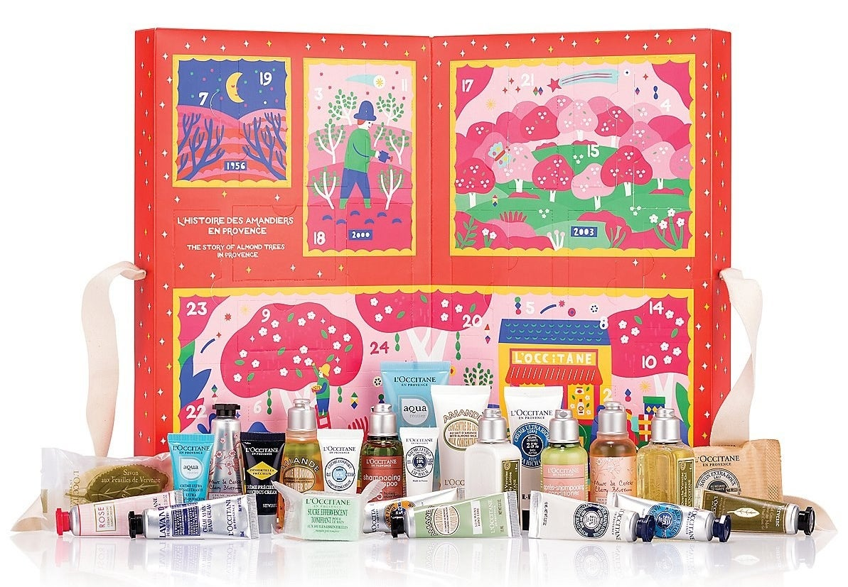 the advent calendar opened to show the inside designs and all the products within