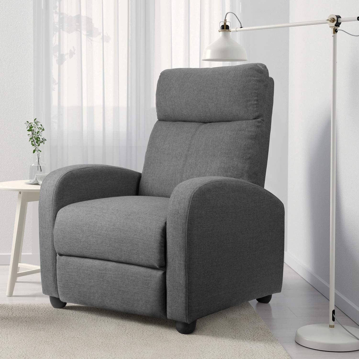 The gray fabric sofa recliner with arms