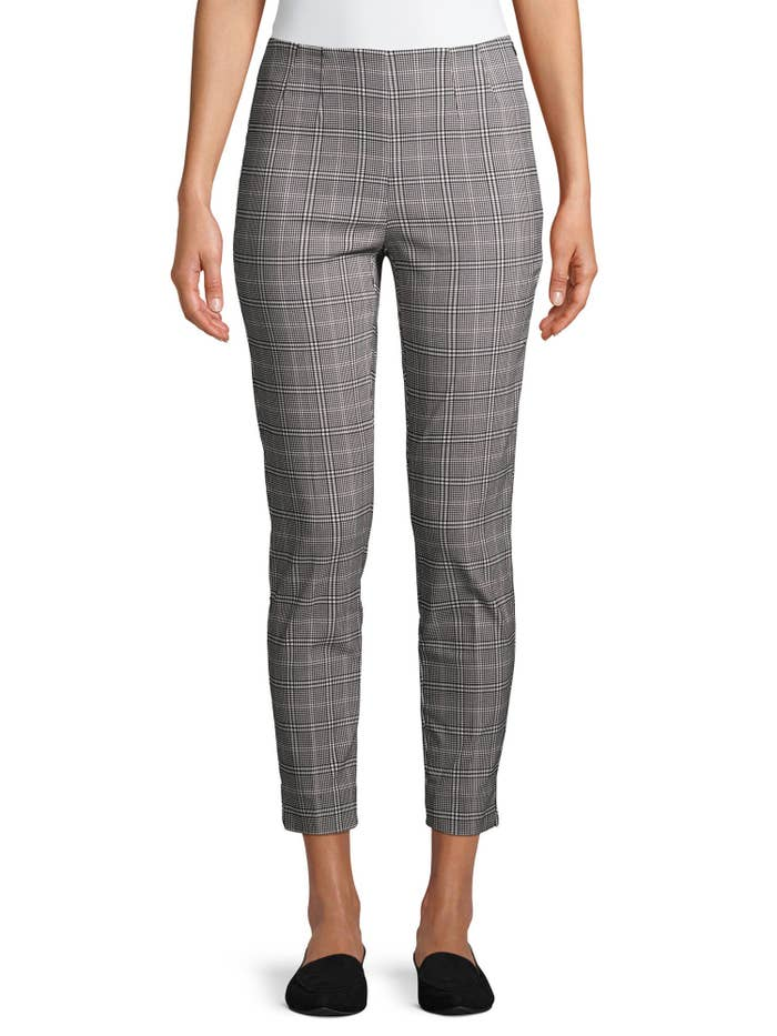 Model wears plaid pants with black flats
