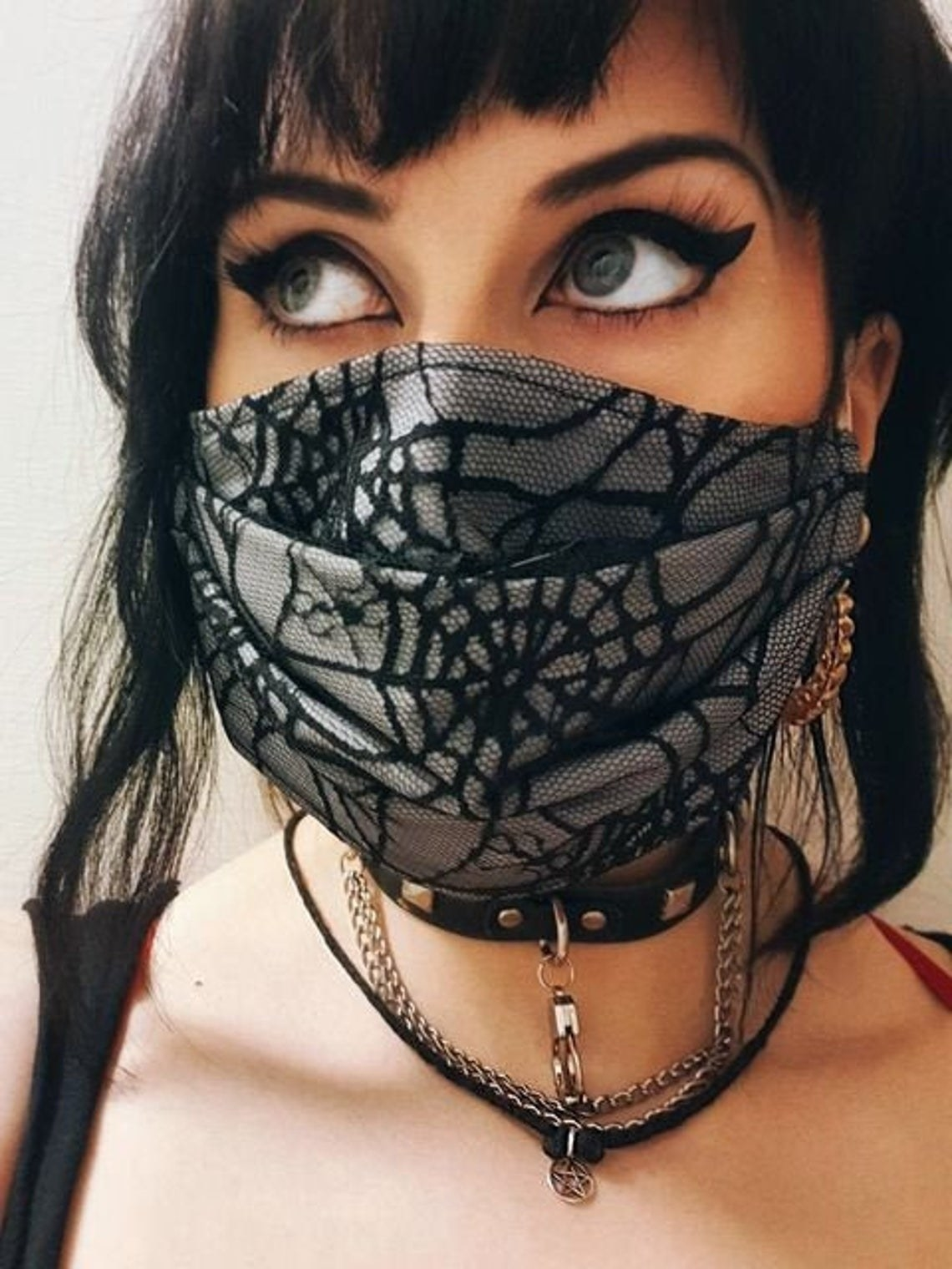 Pleated gray mask with black spiderweb lace on top