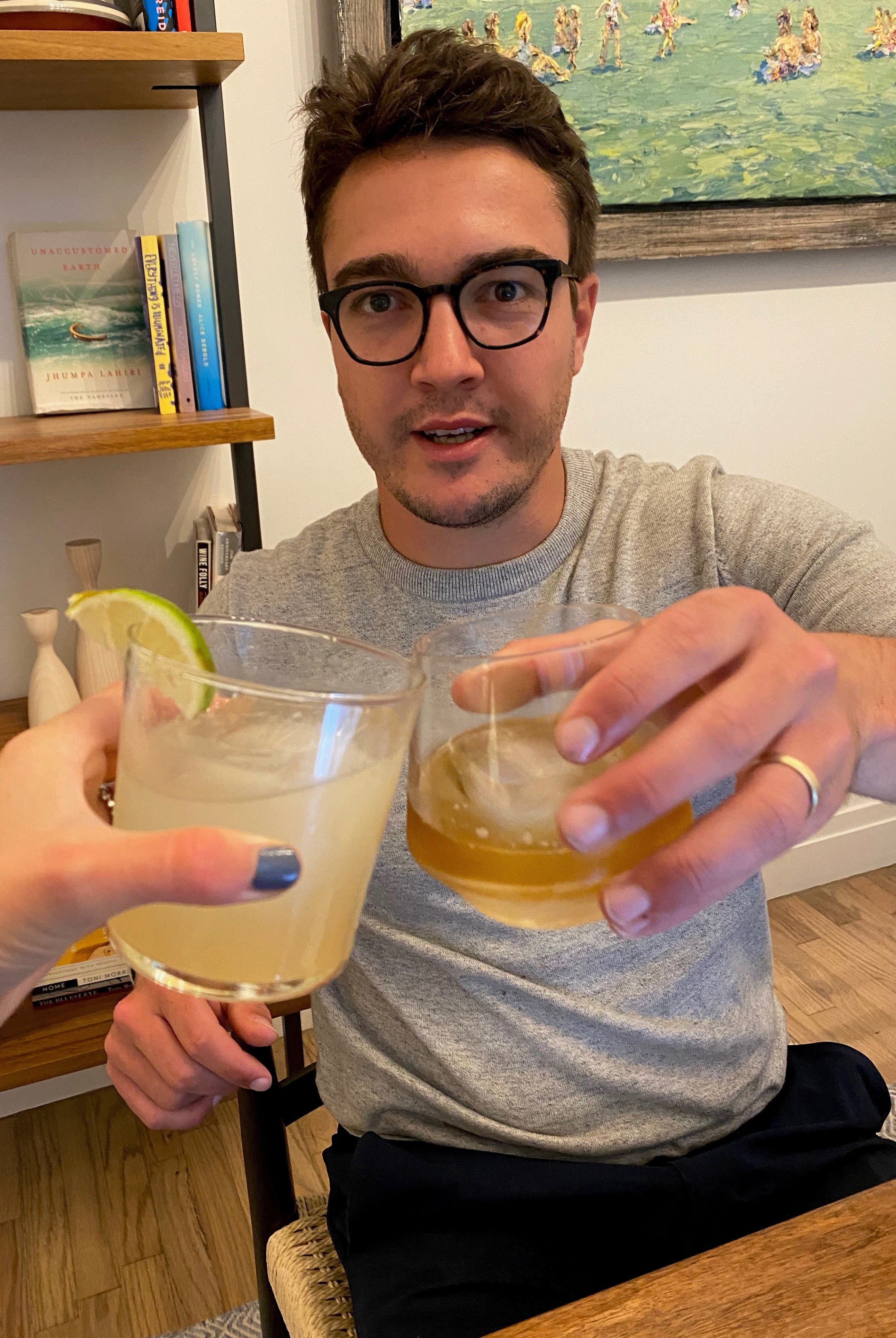 My husband and I cheers-ing with our Bartesian cocktails.