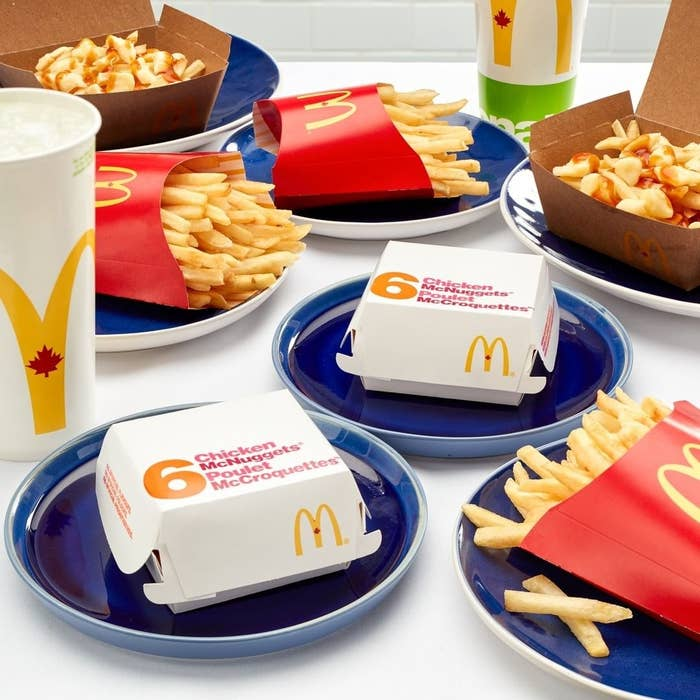 Several boxes of nuggets, fries, and drinks