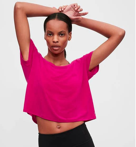 A model wearing the cropped tee and looking directly into the camera