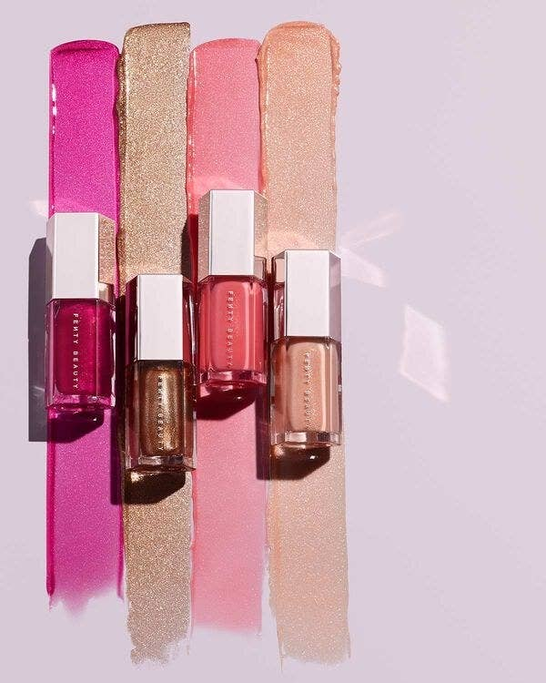 The glosses: one hot pink, one golden, one light pink, and one rose golden