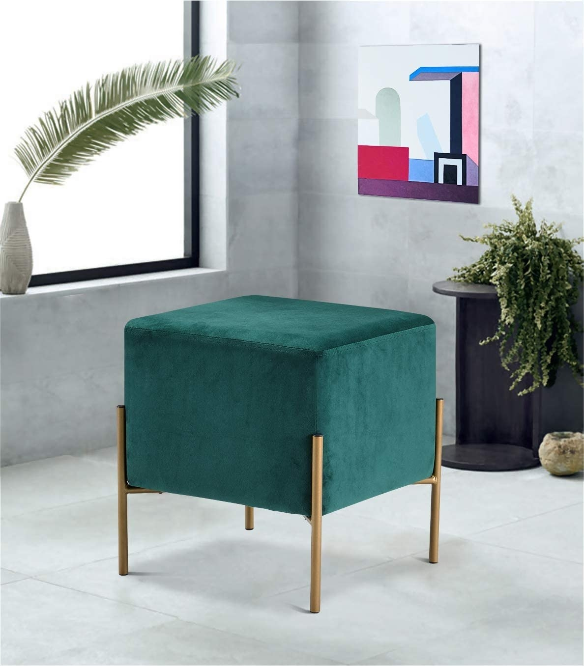A square-shaped ottoman that fits into sleek gold leg frames