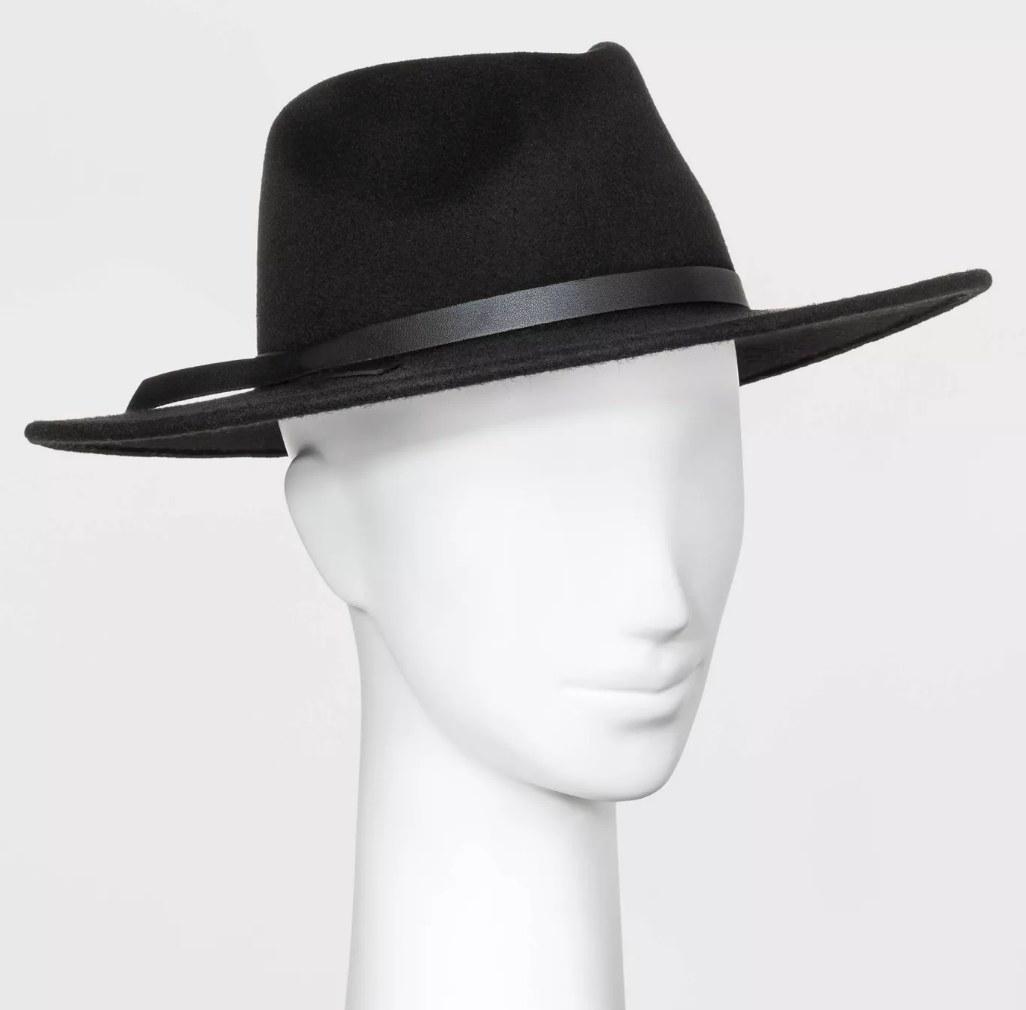 Mannequin wearing black flat brimmed hat