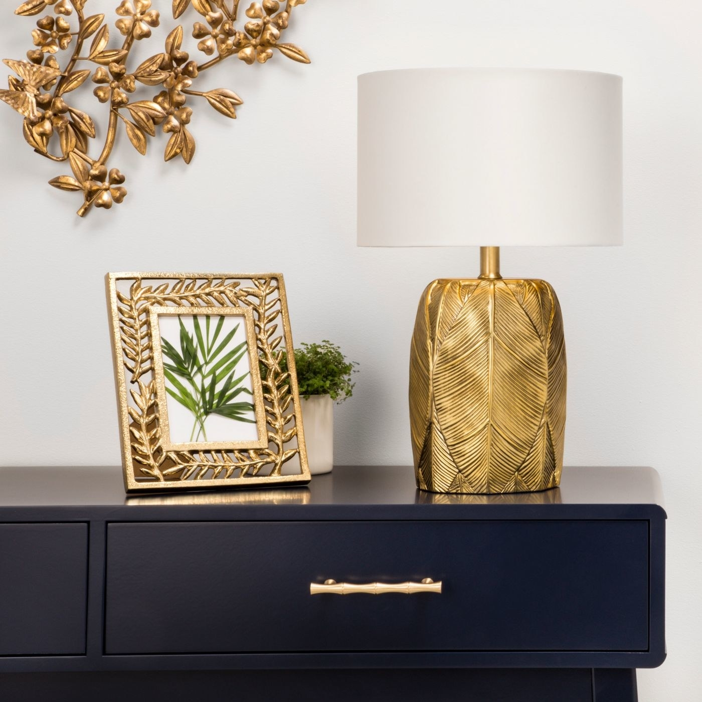 The lamp featured on top of a matching side table